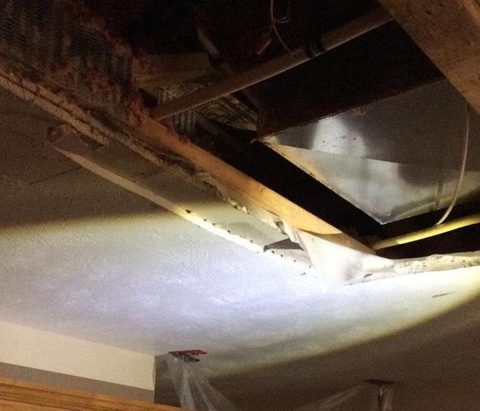 Ceiling gutted to assess water damage and source