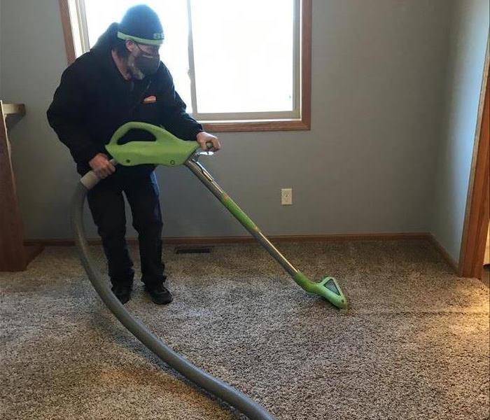 SERVPRO male employee using water extraction tool