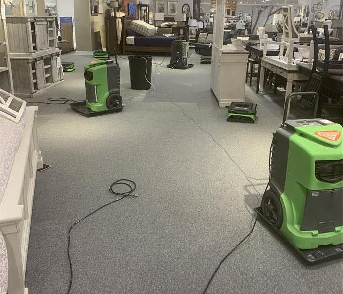 SERVPRO equipment working to dry a large commercial water loss