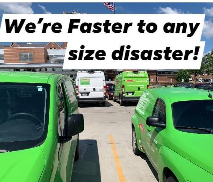 4 SERVPRO Vehicles on job site