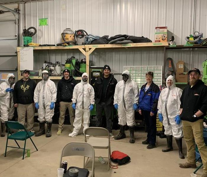 SERVPRO Staff wearing protective suits