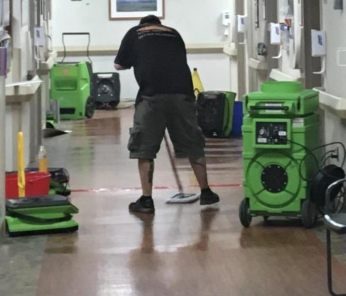 SERVPRO Employee mopping up water