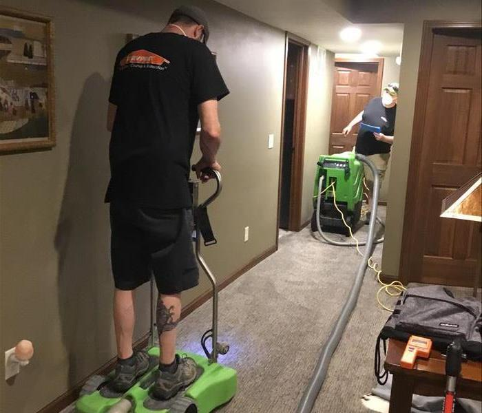 Employee using SERVPRO Equipment