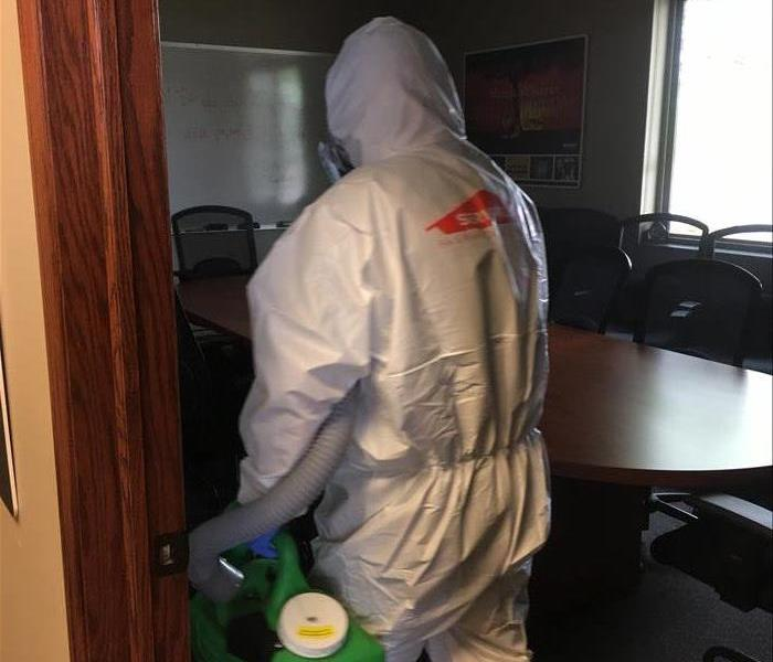 SERVPRO employee spraying disinfectant