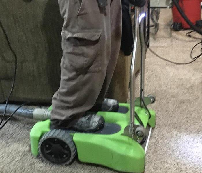SERVPRO Employee Using Drying Equipment