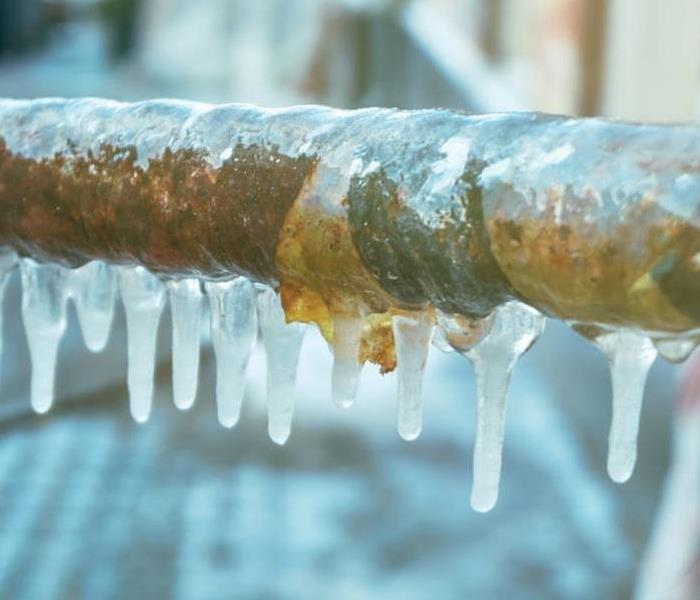 Exterior pipe covered with ice