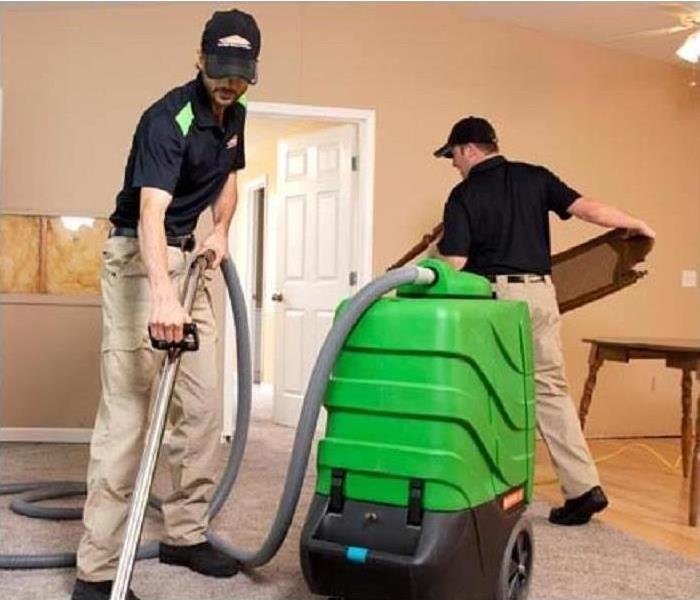 SERVPRO Employees cleaning carpet